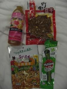 "peach tea, veggie jerky ""bean beef"", cashews, seaweed snack"