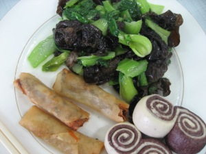 a desperate lunch. veggie spring rolls, greens and mushrooms, bread