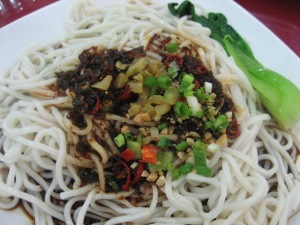 Sichuan noodles. No real sauce, only fried onions, chillies and soy sauce and lots of raw garlic